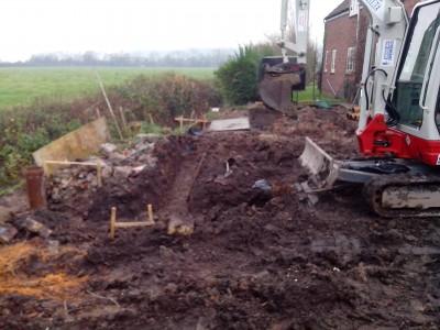 Piles complete excavating ground beams.