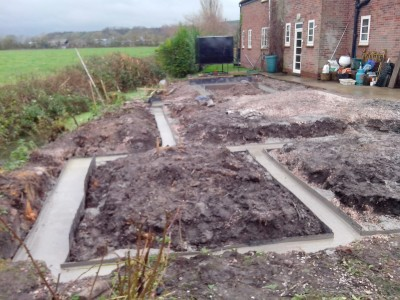 Piled ground beams complete, and concrete finished.