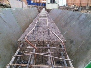 Capping beam stripped and washed with retarding agent to allow for connection of floor slab.