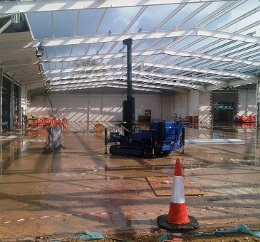 Steel cased bottom driven piles for mezzenine floor in shop refit